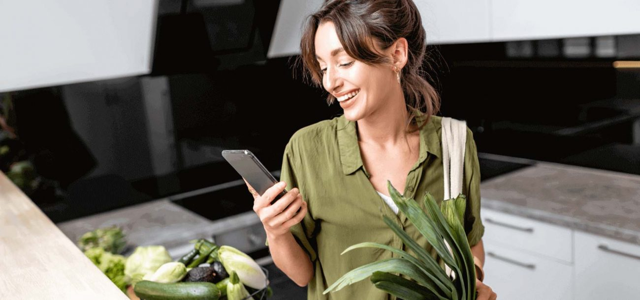 woman shopping for grocery on mobile showing how the industry has changed
